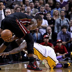 March 10, 2011; Miami, FL, USA; Miami Heat power forward Chris Bosh (1) keeps the ball away from Los Angeles Lakers power forward Lamar Odom (7) late in the fourth quarter at the American Airlines Arena. The Heat defeated the Lakers 94-88.   Mandatory Credit: Derick E. Hingle