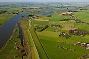 Nederland, Overijssel, Zwolle, 03-10-2010; de IJssel ter hoogte van Westenholte. In het kader van het programma Ruimte voor de rivier zal de dijk landinwaarts verlegd worden. Ook worden er geulen gegraven die zullen aansluiten op de bestaande geul (boven in beeld). Door de dijkverlegging worden de uiterwaarden breder en krijgt de rivier meer ruimte..River IJssel north of Zwolle. There are plans to move the river dike inland and new 'channels' will be dug that will connect with the existing channel (top image). Moving the dike will broaden the floodplains creating more space for the river..luchtfoto (toeslag), aerial photo (additional fee required).foto/photo Siebe Swart