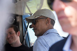 Former US president Barack Obama playing golf at St Andrews. With Sir Tom Hunter in the kiosk not fancying the Irn Blu.