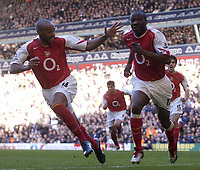 Fotball<br /> England 2004/2005<br /> Foto: SBI/Digitalsport<br /> NORWAY ONLY<br /> <br /> Tottenham Hotspur v Arsenal<br /> 13/11/2004<br /> <br /> Arsenal's Lauren celebrates his goal with team mate Thierry Henry