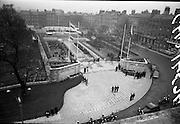 11/04/1966<br /> 04/11/1966<br /> 11 April 1966<br /> 1916 Jubilee Commemorations- Opening and Blessing Ceremony at the Garden of Remembrance, Parnell Square, Dublin. Image shows a view of the Garden and the ceremony. In foreground is the army motorcycle unit. On right is the National Ballroom.