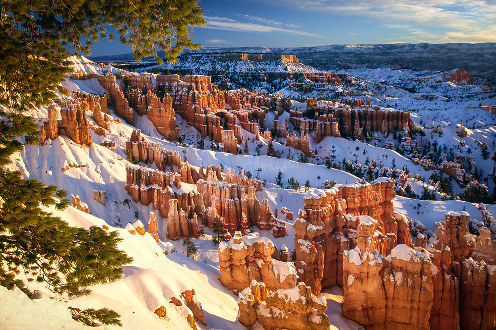 Sunset Point in Bryce Canyon National Park in southern Utah. Bryce Canyon National Park, a sprawling reserve in southern Utah, is known for crimson-colored hoodoos, which are spire-shaped rock formations. The park's main road leads past the expansive Bryce Amphitheater, a hoodoo-filled depression lying below the Rim Trail hiking path. It has overlooks at Sunrise Point, Sunset Point, Inspiration Point and Bryce Point. Prime viewing times are around sunup and sundown.