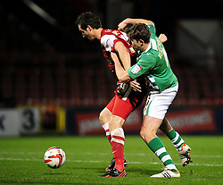 Leyton Orient's David Mooney  holds the ball up from Yeovil Town Dominic Blizzard - Photo mandatory by-line: Dougie Allward/JMP - Tel: Mobile: 07966 386802 09/01/2013 - SPORT - FOOTBALL - Matchroom Stadium - London -  Leyton Orient v Yeovil Town - Johnstone's Paint Trophy Southern area semi-final.