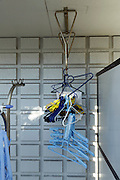 clothing hangers together by an outdoor balcony wash line rack