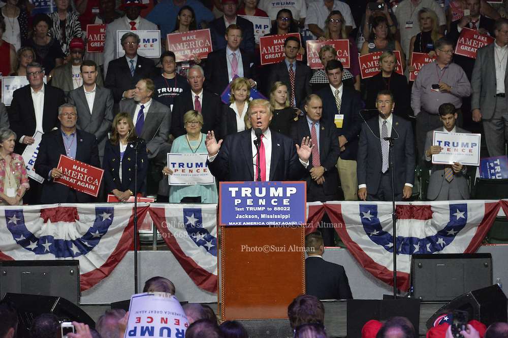 """8/24/16 Jackson,MS. 8/24/16 Jackson,MS. Republican Presidential candidate Donald J. Trump stumps in Jackson Mississippi at the coliseum to a full house of mostly white supporters and calls Hillary Clinton a """"bigot"""" during his speech. While in Jackson Trump also made time to squeezed in a very private $1,000 dollar  per person fundraiser. It was so private you did not get the address for the location until the campaign received your donation. Photo © Suzi Altman"""