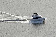 Cortlandt Manor, NY - A  motor boat speeds up the Hudson River south of the Bear Mountain Bridge on Nov. 2, 2008.