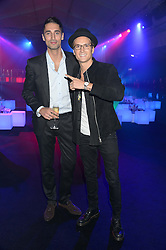 Left to right, HUGO TAYLOR and OLLIE PROUDLOCK at a party to celebrate the 1st birthday of nightclub 2&8 at Mortons held in Berkeley Square, London on 3rd October 2013.