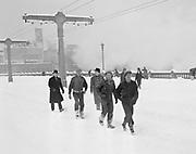 9969-2843. People walking to work across the Burnside Bridge. February 1, 1937.
