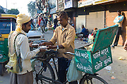 Old Delhi, Daryagang fruit and vegetable market with curry sold from a bicycle stall, India