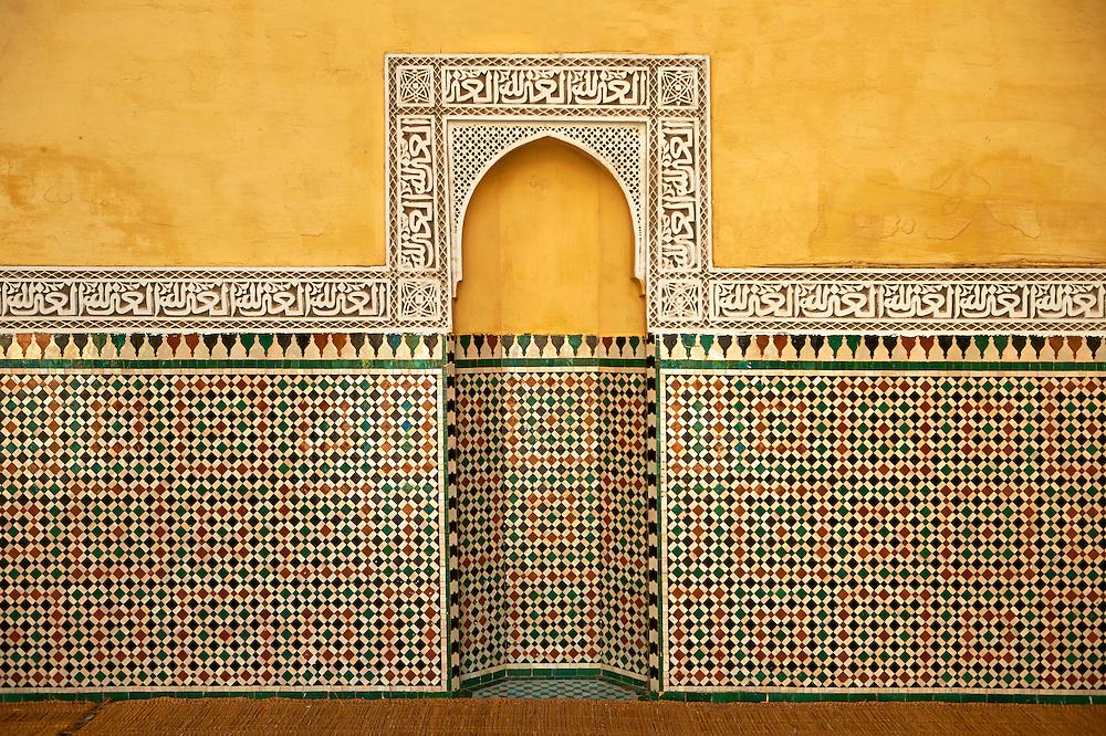 Berber Mocarabe Honeycomb work plaster decorations and Berber design tiles of the Mauseleum of Moulay Ismaïl Ibn Sharif , reigned 1672–1727. A UNESCO World Heritage Site .Meknes, Meknes-Tafilalet, Morocco.
