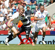 Picture by Andrew Tobin/Tobinators Ltd +44 7710 761829.26/05/2013.Billy Twelvetrees of England breaks a tackle during the match between England and the Barbarians at Twickenham Stadium, Twickenham.