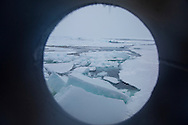 The view out of the ship's portal out to the ice flow, Arctic Svalbard, Norway