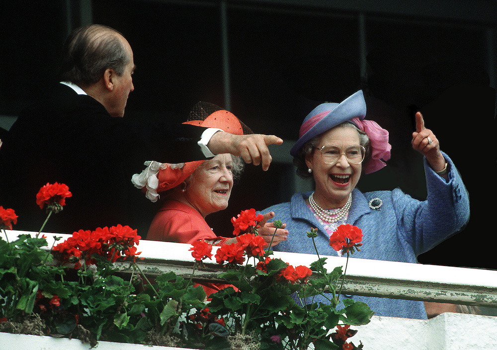 The Queen with the Queen Mother and the Earl of Caernarvon seen watching one of Her Majesty's horses run in the Epsom Derby race in June 1991. Photograph by Jayne Fincher
