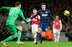Man Utd Forward Robin van Persie (NED) llooks on as Arsenal Goalkeeper Wojciech Szczesny (POL) rushes out to gather the ball - Photo mandatory by-line: Rogan Thomson/JMP - 07966 386802 - 12/02/14 - SPORT - FOOTBALL - Emirates Stadium, London - Arsenal v Manchester United - Barclays Premier League.