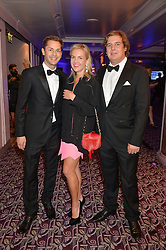 Left to right, SIMON PICKETT, HANNELI RUPERT and ANTON RUPERT at the WGSN Global Fashion Awards 2015 held at The Park Lane Hotel, Piccadilly, London on 14th May 2015.