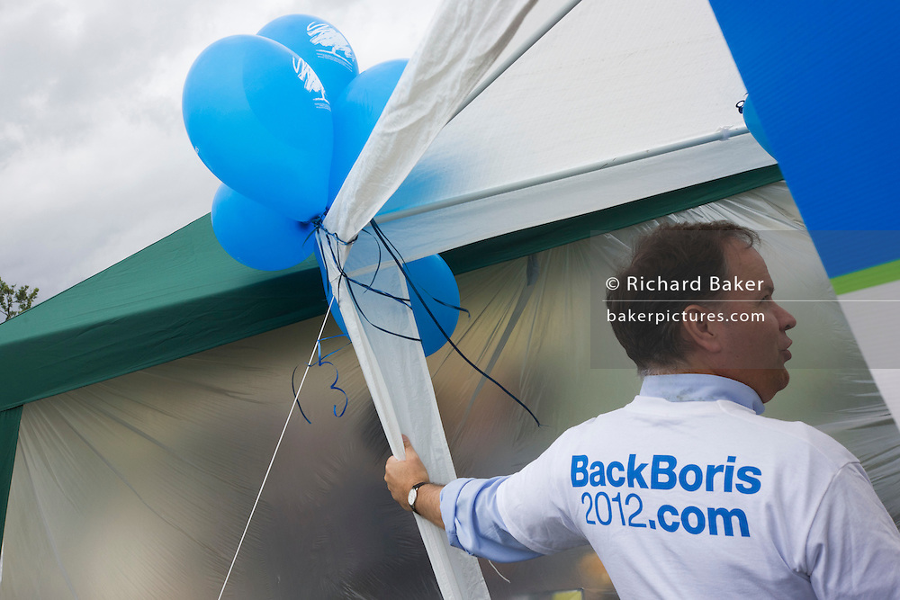 A Conservative Party's Back Boris Johnson for London mayor campaign supporter at the Lambeth Fair in Brockwell Park.