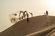 Children play on a Desert sand dune