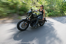 Lilly James of the Iron Lilies out riding during Laconia Motorcycle Week 2016. NH, USA. Sunday, June 19, 2016.  Photography ©2016 Michael Lichter.