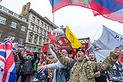 January 31, 2020, London, England, United Kingdom: Brexit supporters celebrate in London, Friday, Jan. 31, 2020. Britain officially leaves the European Union on Friday after a debilitating political period that has bitterly divided the nation since the 2016 Brexit referendum. (Credit Image: © Vedat Xhymshiti/ZUMA Wire)
