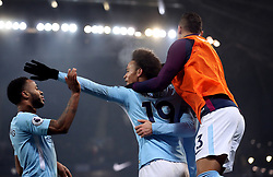 Manchester City's Raheem Sterling (left) celebrates scoring his side's third goal of the game with Leroy Sane (centre) during the Premier League match at the Etihad Stadium, Manchester.