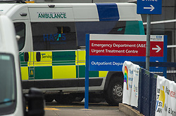 © Licensed to London News Pictures. 08/07/2020. London, UK. A sign pointing to the Emergency Department with an ambulance in the background at Hillingdon Hospital. Hillingdon Hospital, a major hospital in west London, has closed to emergency ambulances and emergency admissions after a number of staff tested positive for the COVID-19 coronavirus, in total 70 staff members are now isolating. Photo credit: Peter Manning/LNP