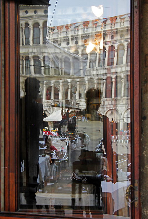 Reflection's in the window of Cafe Florian, Venice, Italy