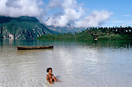 A Sawai village youngster enjoys the clear waters off Sawai Island.