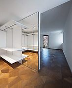 Large white walk-in closet with parquet. Nobody inside, copy space