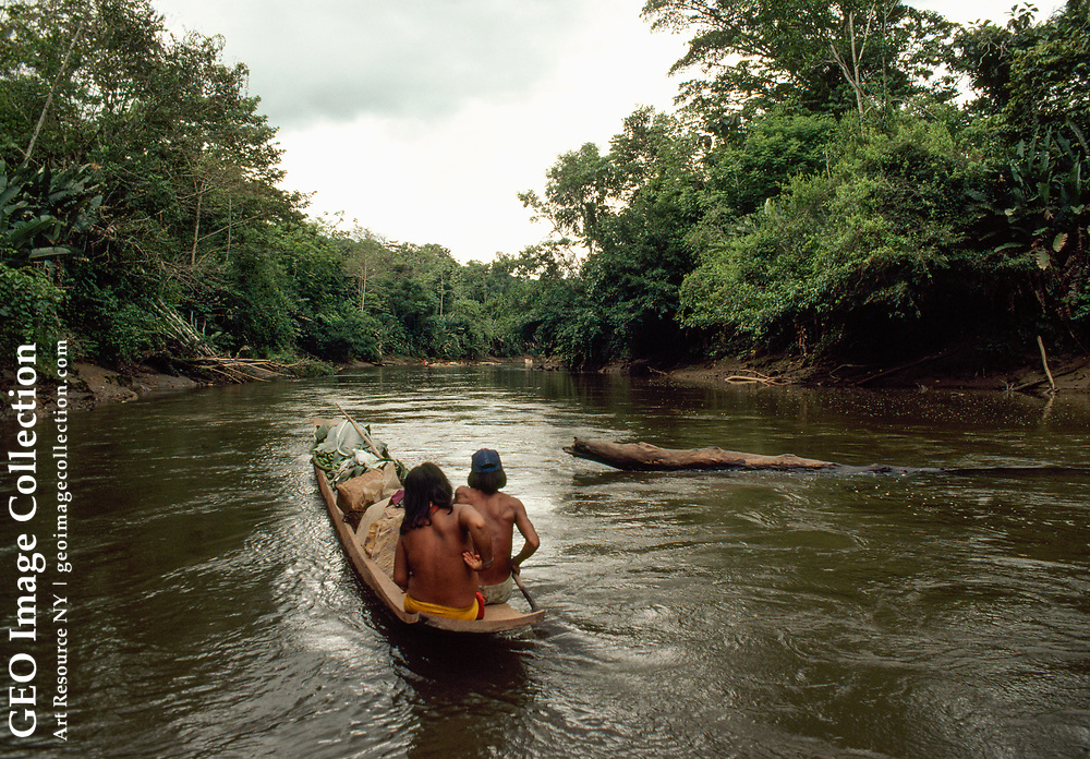 Choco Indians taking plantains to market by boat.