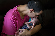 Angel Santiago kisses infant nephew Roman Santiago, born nine days after the Pulse shooting, at home in Sanford, Florida, U.S. Santiago balanced uncle-duties with his own rehabilitation once home from the hospital.