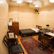 The bedroom and living quarters of Brendan Bracken, the Minister of Information, at the Churchill War Rooms in London. The museum, one of five branches of the Imerial War Museums, preserves the World War II underground command bunker used by British Prime Minister Winston Churchill. Its cramped quarters were constructed from a converting a storage basement in the Treasury Building in Whitehall, London. Being underground, and under an unusually sturdy building, the Cabinet War Rooms were afforded some protection from the bombs falling above during the Blitz.