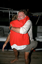 05 April 2011. St Maarten, Antilles, Caribbean.<br /> Wives of sailors see their husbands for the first time in over 9 weeks. Trisha Baily leaps into the arms of David Hildred and  can barely contain her excitement.<br /> After more than 9 weeks at sea, having started in the Canary islands, the 'Antiki' transatlantic raft gets set to arrive in St Maarten in the Caribbean following an epic voyage. The incredible vessel is crewed by Anthony Smith (84 yrs old) British adventurer, David Hildred, sailing master and British Virgin Islands resident, Dr Andrew Bainbridge of Alberta, Canada and John Russell, solicitor and UK resident.<br /> Photo; Photo; Charlie Varley/varleypix.com