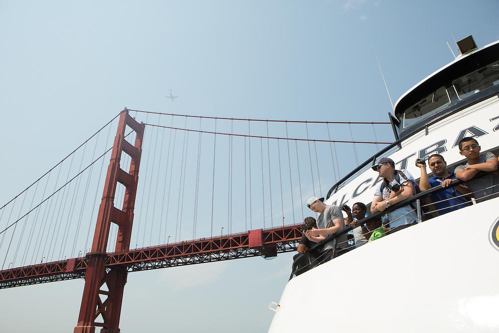 A sightseeing boat under the Golden Gate Bridge in San Francisco, California. Copyright 2015 John O'Boyle<br /> john@johnoboyle.com