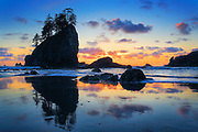 Sunset at Second Beach in Washington state's Olympic National Park<br /> .....<br /> Olympic National Park is a United States national park located in the state of Washington, on the Olympic Peninsula. The park has four basic regions: the Pacific coastline, alpine areas, the west side temperate rainforest and the forests of the drier east side. Within the park there are three distinct ecosystemswhich are sub-alpine forest and wildflower meadow, temperate forest, and the rugged Pacific Shore. These three different ecosystems are in pristine condition and have outstanding scenery. U.S. President Theodore Roosevelt originally created Mount Olympus National Monument on 2 March 1909. It was designated a national park by President Franklin Roosevelt on June 29, 1938. In 1976, Olympic National Park became an International Biosphere Reserve, and in 1981 it was designated a World Heritage Site. In 1988, Congress designated 95 percent of the park as the Olympic Wilderness.