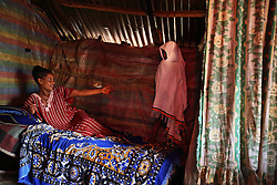 Elsa Haile, 20, beckons her daughter Senaiet, 5, in the early morning before church in Bahir Dar, Ethiopia on May 27, 2007.  At age 11, Elsa ran away from home the day she was supposed to get married to a neighboring villager. She was later offered a job in a restaurant, but it turned out to be a brothel. Elsa does not know who fathered her daughter and has yet decided to test herself or her child for HIV, but she hopes to someday escape from nightmare her life has become.