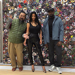 """Kim Kardashian releases a photo on Twitter with the following caption: """"""""Tokyo with @takashipom"""""""". Photo Credit: Twitter *** No USA Distribution *** For Editorial Use Only *** Not to be Published in Books or Photo Books ***  Please note: Fees charged by the agency are for the agency's services only, and do not, nor are they intended to, convey to the user any ownership of Copyright or License in the material. The agency does not claim any ownership including but not limited to Copyright or License in the attached material. By publishing this material you expressly agree to indemnify and to hold the agency and its directors, shareholders and employees harmless from any loss, claims, damages, demands, expenses (including legal fees), or any causes of action or allegation against the agency arising out of or connected in any way with publication of the material."""