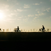 In Pyonyang, along the Taedong river, in the mist of the morning. Bicyles remains the most used way to commute in Pyonyang, while, in the other parts of the country, people are mostly walking.
