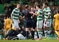 06/03/16 WILLIAM HILL SCOTTISH CUP QUARTER-FINAL<br /> CELTIC v MORTON<br /> CELTIC PARK - GLASGOW<br /> The Celtic players speak to referee Willie Collum (3rd from left) as Stefan Johansen (grounded) lies injured