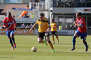 Newport's Miles Storey (c) breaks through flanked by Dagenham's Andre Bougard (28) and Matt Partridge (21). Skybet football league two match , Newport county v Dagenham & Redbridge at Rodney Parade in Newport, South Wales on Saturday 18th April 2015.<br /> pic by David Richards, Andrew Orchard sports photography.