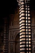 Striped column inside the Duomo of Siena, Sienna, Tuscany, Italy.