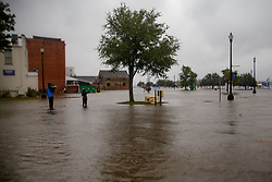 September 14, 2018 - Washington, North Carolina, U.S. - Rising waters threaten downtown Washington, NC as the Pimlico River overruns its' banks, a result of storm surge from Hurricane Florence. (Credit Image: © Michael Candelori/ZUMA Wire)