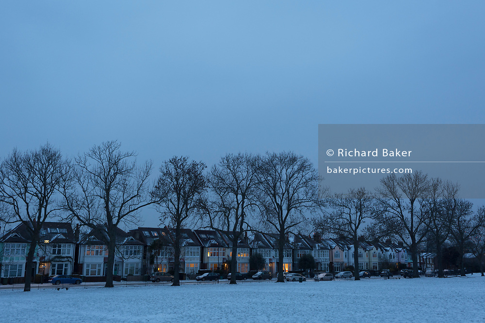 Edwardian period homes in blue evening light on a winter's afternoon in Ruskin Park south London during the bad weather covering every part of the UK and known as the 'Beast from the East' because Siberian winds and very low temperatures have blown across western Europe from Russia, on 1st March 2018, in Lambeth, London, England.
