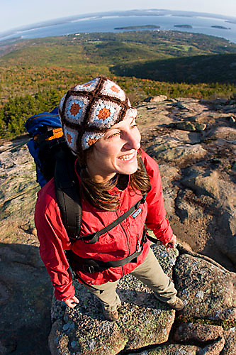 Young woman hiking on Cadillac Mountain in Acadia National Park. Bar Harbor, Maine.