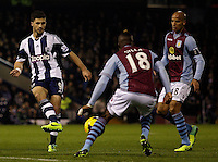 West Bromwich Albion's Shane Long in action against Aston Villa's Yacouba Sylla.<br /> <br /> Photo by James Marsh/CameraSport<br /> <br /> Football - Barclays Premiership - West Bromwich Albion v Aston Villa - Monday 25th November 2013 - The Hawthorns - West Bromwich<br /> <br /> © CameraSport - 43 Linden Ave. Countesthorpe. Leicester. England. LE8 5PG - Tel: +44 (0) 116 277 4147 - admin@camerasport.com - www.camerasport.com