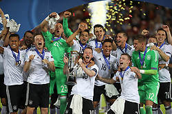 Germany's Maximilian Arnold lifts the UEFA European Under-21 Championship Trophy with teammates