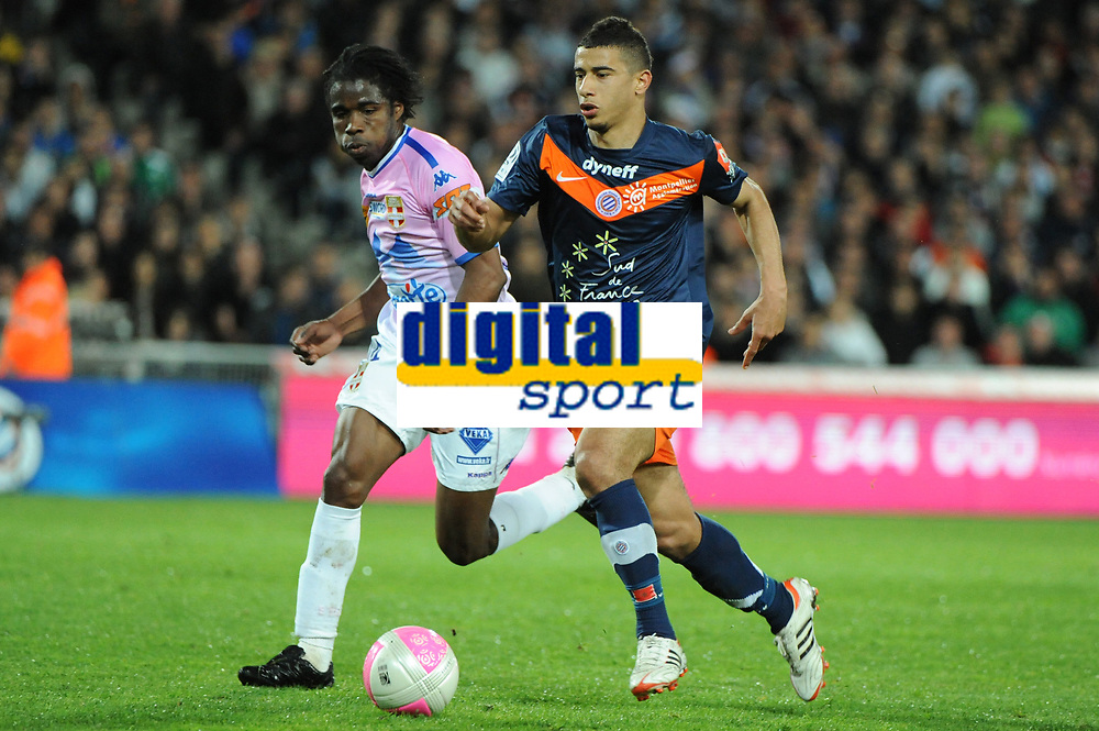 FOOTBALL - FRENCH CHAMPIONSHIP 2011/2012 - L1 - MONTPELLIER HSC v EVIAN TG - 1/05/2012 - PHOTO SYLVAIN THOMAS / DPPI - YOUNES BELHANDA (MHSC) / ERIC TIE BI (EVI)