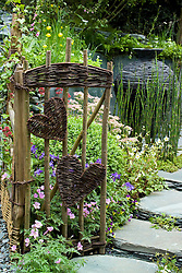 Rustic gate with woven heart shaped panels. The Cumbrian Fellside Garden. Design: Kim Wilde and Richard Lucas - Chelsea 2005