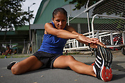 """2016/06/15 – Medellín, Colombia: Maritza Arango, 38, stretches before a training session at Atanasio Girardot Stadium in Medellín, 15th June 2016. <br /> -<br /> 18 years ago Maritza discovered that she suffered from """"Retinitis Pigmentosa"""", a disease of the eye that leads to loss of vision and eventually to blindness. <br /> Maritza used to live in Argelia, a village of Antioquia Department, where her family had a farm and the little town's only shop. Her family were forced to sell products to everyone, including all the different armed forces that operated in the area. Rumours started circulating that her family would be a target by the guerrillas. Her family decided to leave the village and move to Medellín. They left with only the clothes they wore. Days after they left, there was a massacre perpetrated by the guerrilla next to her house. With time Maritza lost completely her sight, and on top of that being displaced she started struggle to make money to support her child. <br /> But her life changed again when in 2008, Maritza was invited by a friend to try athletics, as a way to make an income. Trials in track running went well. In two years she started to go to international competitions, and in 2011 she won a silver medal on 800 meters at the World Championships in New Zealand. A result she repeated again in the 2013 World Championships in France. In 2015 she won silver on 1,500 meters.<br /> This year in Rio de Janeiro she expects to win a medal, since she is considered second best in the world in her category. But for Maritza the most amazing thing is that she never thought she would be a sportswoman. She confesses that before she didn't even know what the athletics or Olympic games were. """"Leaving my town was like a blessing. When I lived there I thought that would be my life. I never imagine this or even getting into a plane. Never, ever…"""" (Eduardo Leal)"""