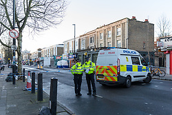 © Licensed to London News Pictures. 30/01/2019. London, UK.  Police at the crime scene in Caledonian Road in Islington, where a 17 year old man suffered stab injuries last night and pronounced dead at the scene by the London Ambulance Service. Two males were arrested near the scene and charged by police on suspicion of murder.  Photo credit: Vickie Flores/LNP