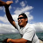 Tadd Fujikawa, a sixteen-year-old professional golfer, fishes off the coast of Honolulu, Hawaii.